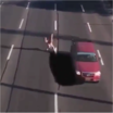 Watch This Guy Finesse Death While He Avoids Cars on a Full-Speed Highway