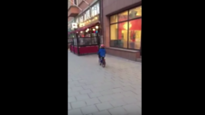 Kid Gets Really Distracted By Strip Club Ad, Crashes Bike