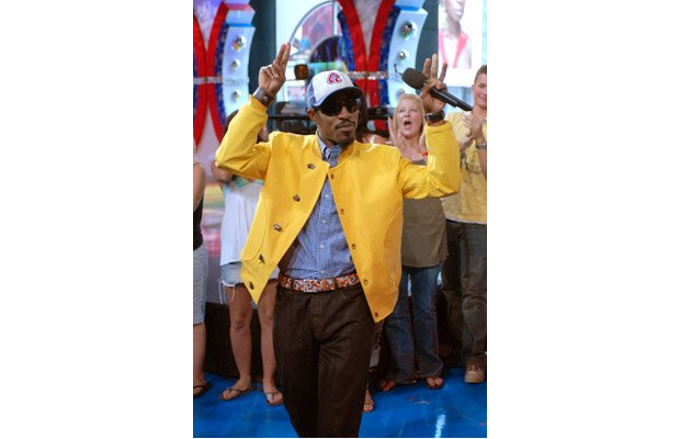 Andre 3000 in a yellow jacket