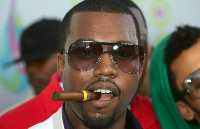 Kanye West with a cigar