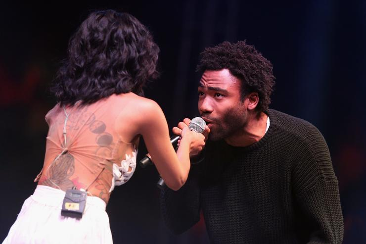 Singer Jhené Aiko (L) and rapper Childish Gambino perform onstage during day 3 of the 2014 Coachella Valley Music & Arts Festival at the Empire Polo Club on April 13, 2014 in Indio, California. (Photo by Imeh Akpanudosen/Getty Images for Coachella)