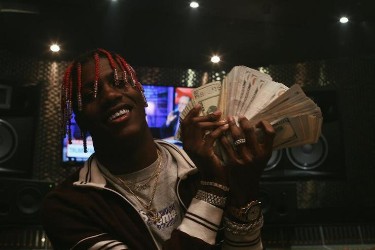 Lil Yachty with stacks of cash