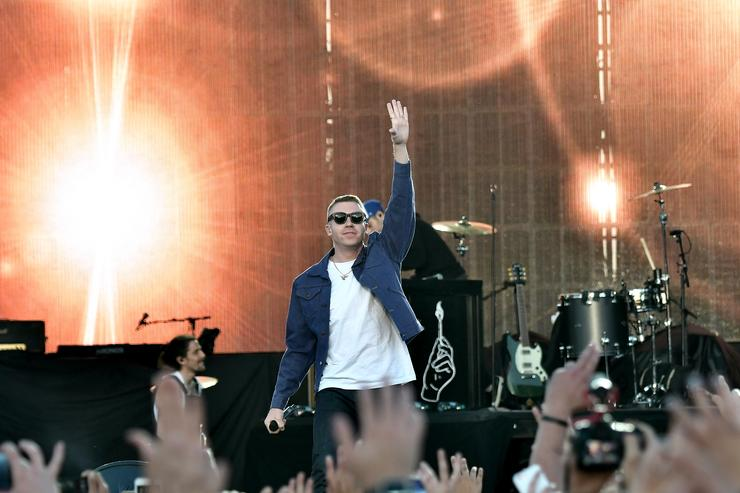 Macklemore charged with driving with suspended liscence